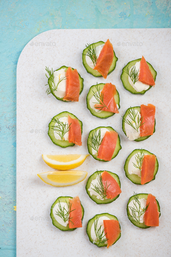 Cucumber canapee with cottage cheese and salmon. - Stock Photo - Images