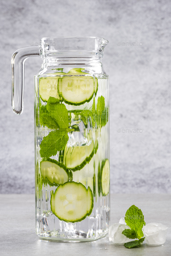 Cucumber and mint lemonade water in jug - Stock Photo - Images