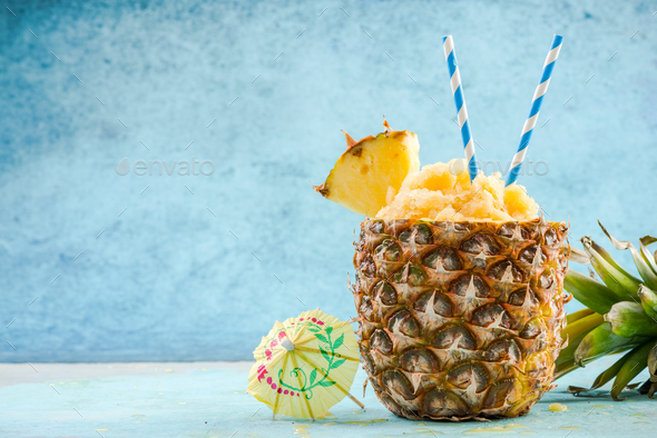 Serving tropical ice granita in pineapple - Stock Photo - Images