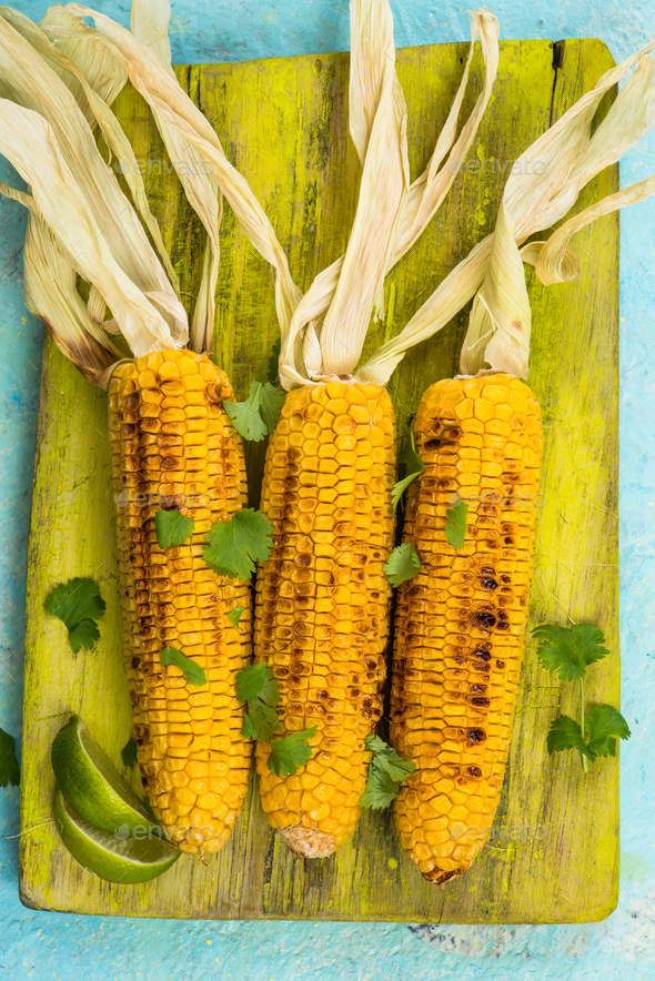 Grilled corn with lime and coriander - Stock Photo - Images