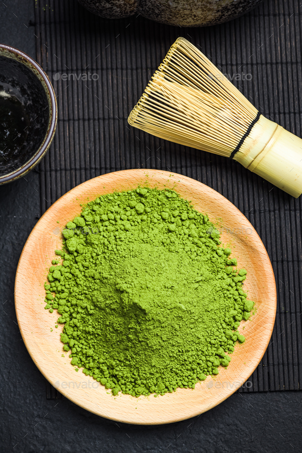Matcha green powder and bamboo tea whisk - Stock Photo - Images