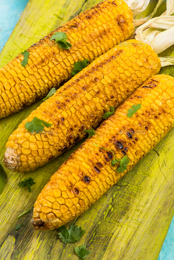 Grilled corn with pesto and coriander - Stock Photo - Images