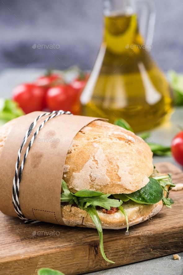 Take away bun with fresh salad - Stock Photo - Images
