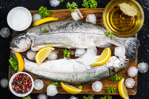 Preparing fresh trout fish for marinate - Stock Photo - Images