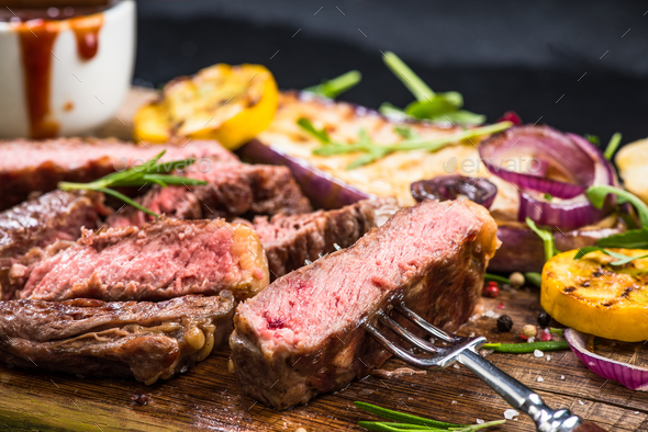 Medium rare steak, close up - Stock Photo - Images