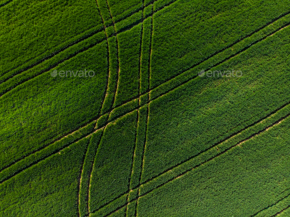 Tractor patterns in  farming fields from drone - Stock Photo - Images