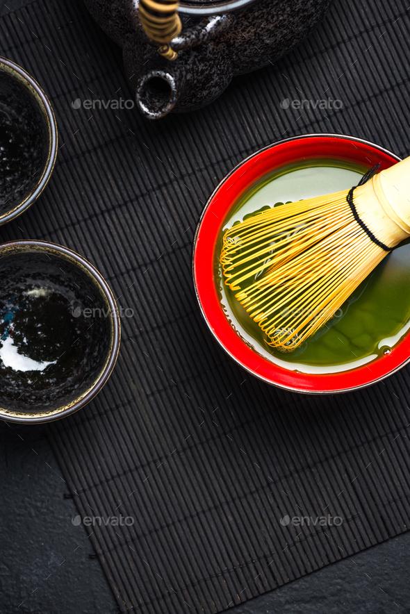 Matcha green tea in ceramic bowl - Stock Photo - Images