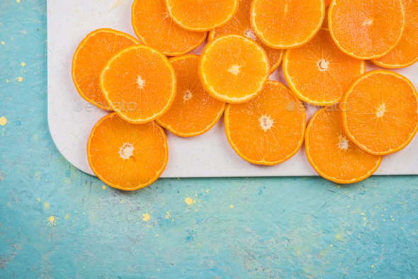 Vibrant orange slices on board - Stock Photo - Images