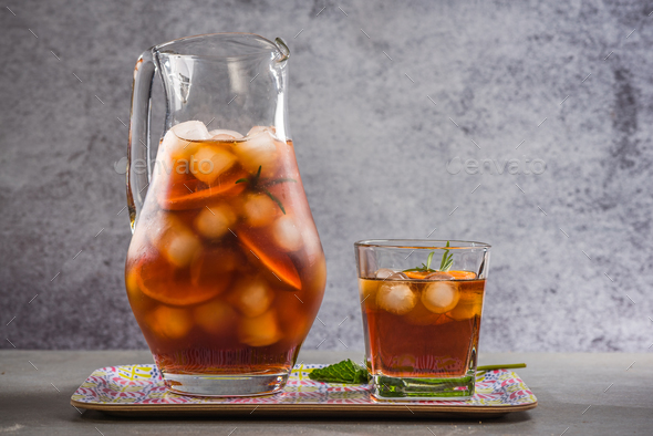 Iced peach tea in jug - Stock Photo - Images