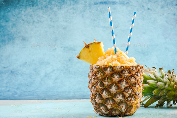 Tropical juice granita served in pineapple - Stock Photo - Images