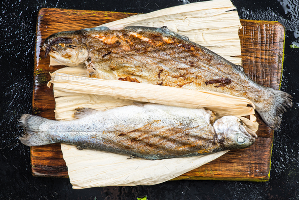 Grilled trout in horn husk - Stock Photo - Images