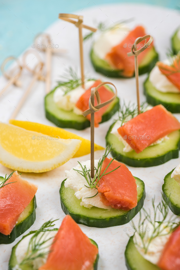 Smoked salmon, cottage cheese and cucumber snack - Stock Photo - Images