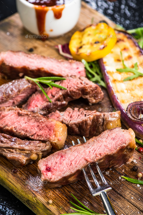 Medium rare beef steak grilled with veggie - Stock Photo - Images