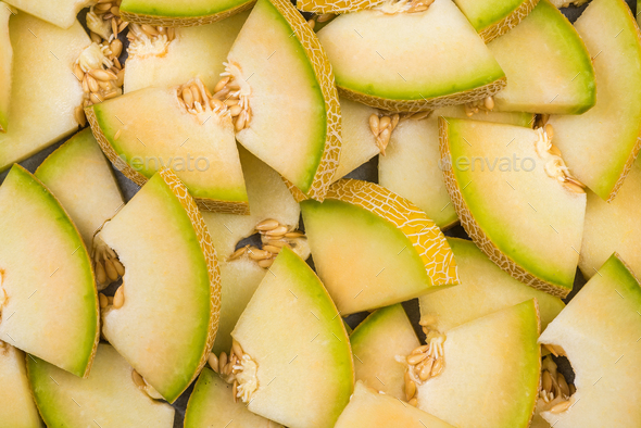 Honeydew melon slices, full frame food background - Stock Photo - Images