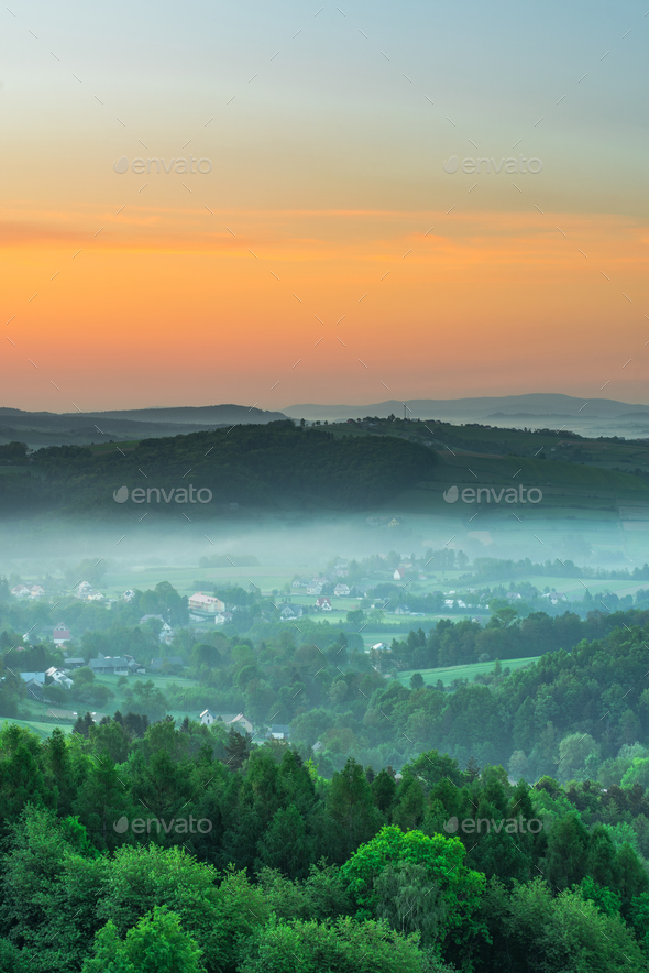 Spring fog over countryside at sunrise - Stock Photo - Images