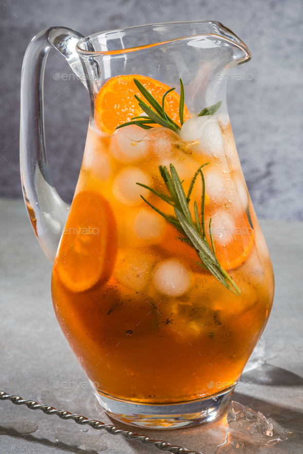 Ice cold tea with rosemary in pitcher - Stock Photo - Images