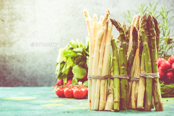 Bunch of asparagus standing on kitchen table - Stock Photo - Images