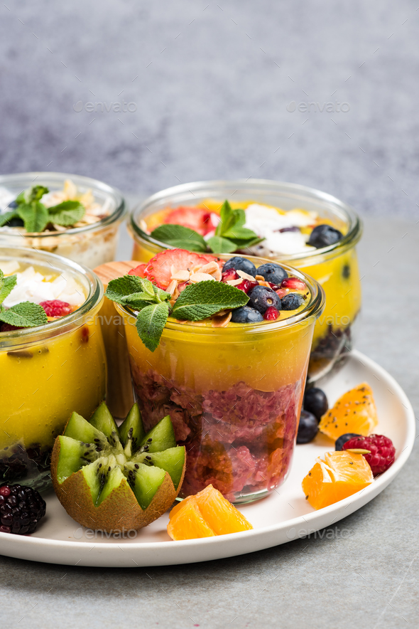 Mango puree and black rice in jar - Stock Photo - Images