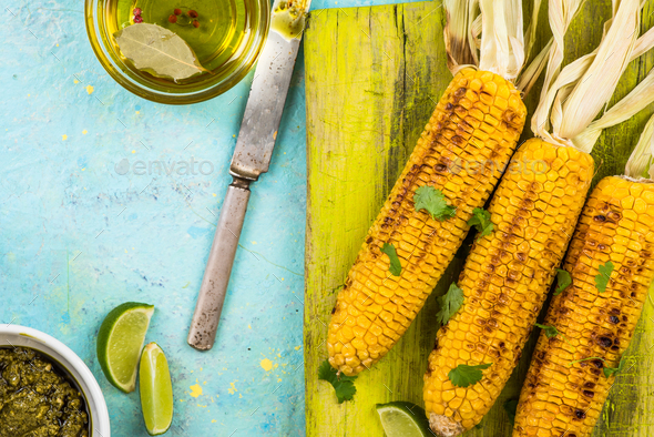 Grilled whole corn on cob with pesto,lime and coriander - Stock Photo - Images