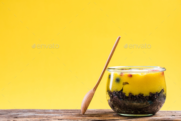 Black rice and mango layered dessert in jar - Stock Photo - Images