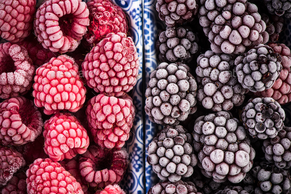 Frozen blackberry and raspberry fruits, close up - Stock Photo - Images