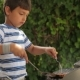 Boy Cooking Steak on the Grill. - VideoHive Item for Sale