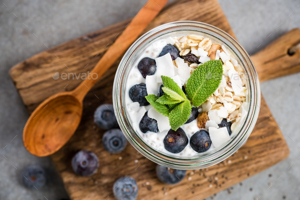 Layered breakfast in jar,blueberry,chia and coconut - Stock Photo - Images