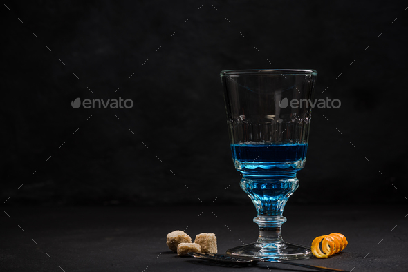Shoot of blue Absinthe, anise vodka - Stock Photo - Images