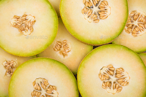 Honeydew green melon slices, food background - Stock Photo - Images