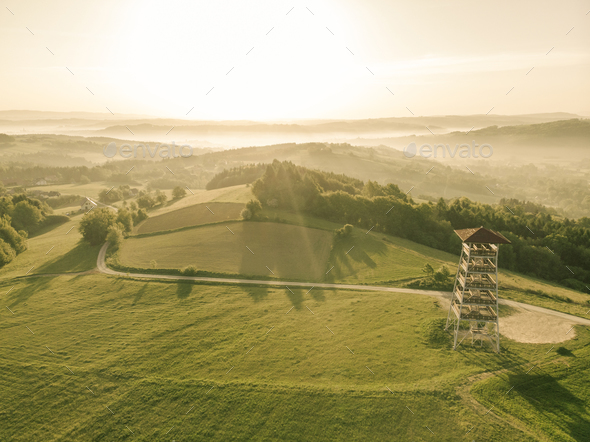 Beautiful aerial view over hills at sunrise - Stock Photo - Images