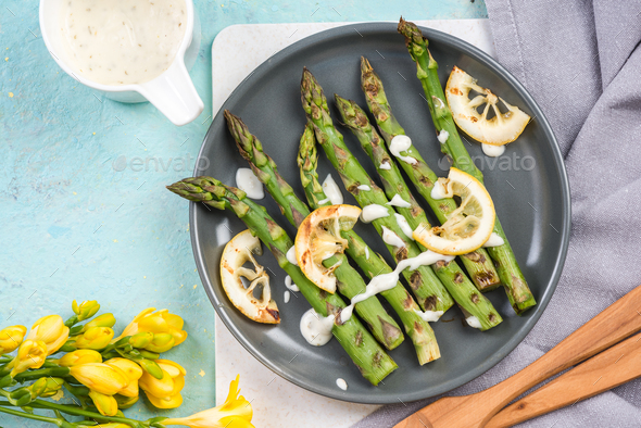 Healthy grilled asparagus with lemon - Stock Photo - Images