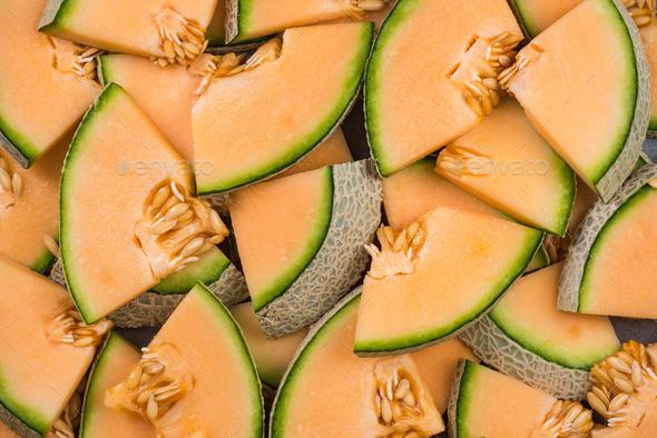 Cantaloupe melon slices, full frame food background - Stock Photo - Images