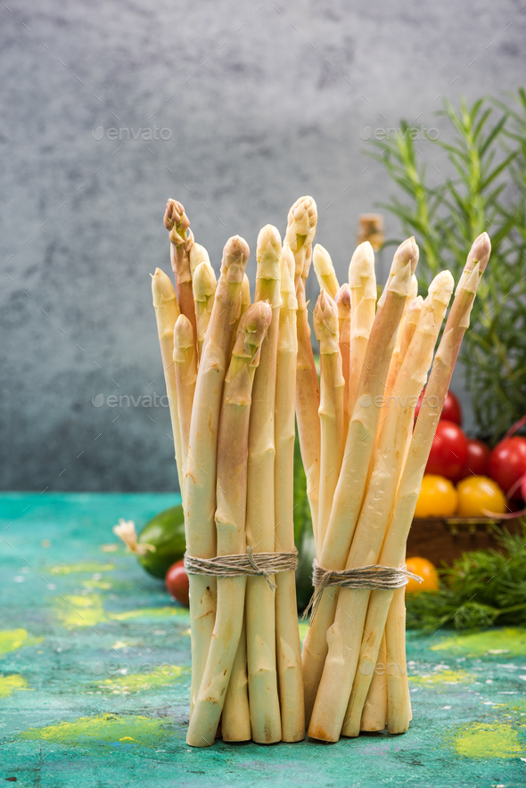 White asparagus bunch standing on table - Stock Photo - Images
