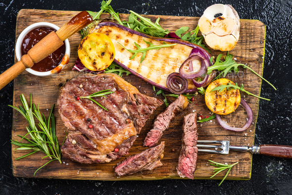 Medium rare steak grilled, top view on board - Stock Photo - Images