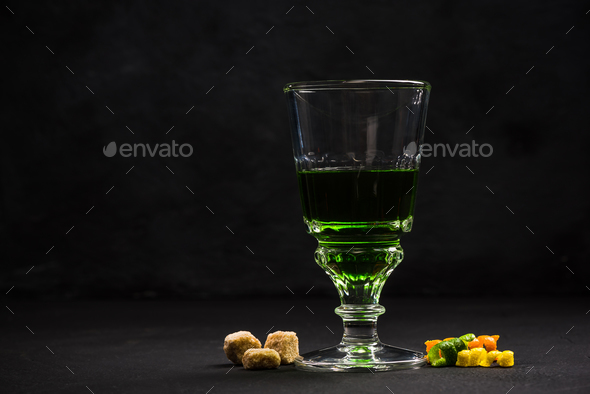 Green Absinthe in crystal glass - Stock Photo - Images