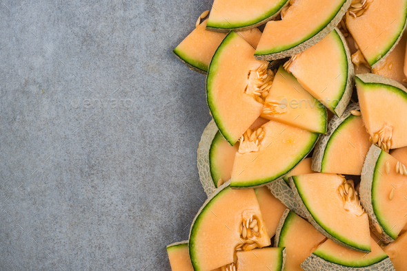 Cantaloupe melon slices, food border background - Stock Photo - Images