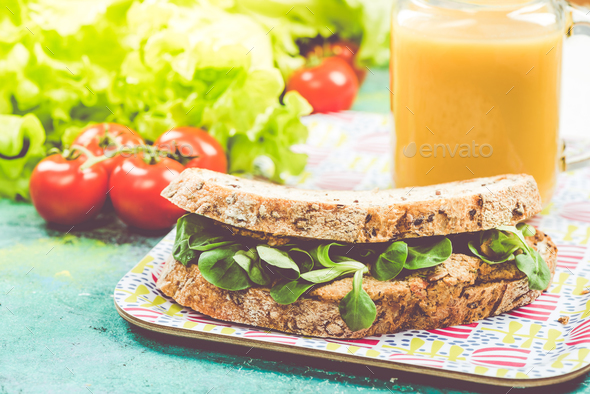 Rye bread with fresh salad and smoothie on tray - Stock Photo - Images