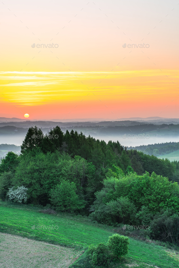 beautiful sunrise over hills foggy morning - Stock Photo - Images