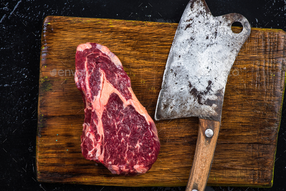 Butcher axe and piece of beef meat steak - Stock Photo - Images