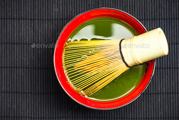 Traditional bamboo whisk and matcha tea - Stock Photo - Images