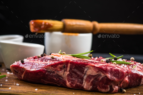 Raw beef meat with herbs and spices - Stock Photo - Images