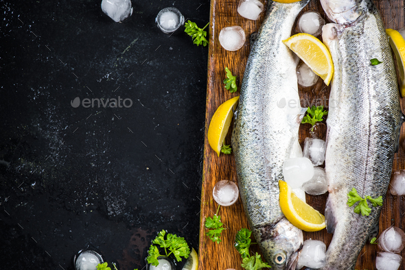 Fresh trout fish, food border background - Stock Photo - Images