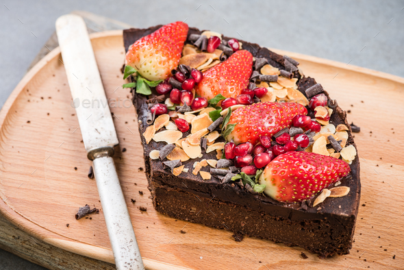 Slice of healthy brownie with strawberry - Stock Photo - Images