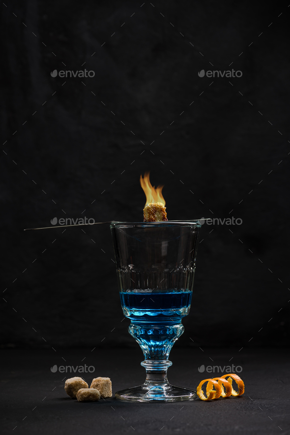 Bohemian style drinking Absinthe vodka - Stock Photo - Images