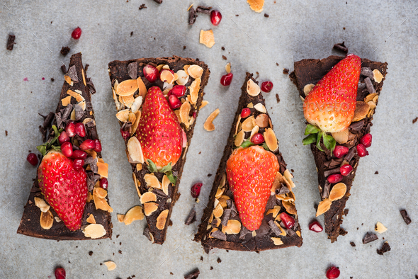 Triangle slices of healthy chocolate brownie - Stock Photo - Images
