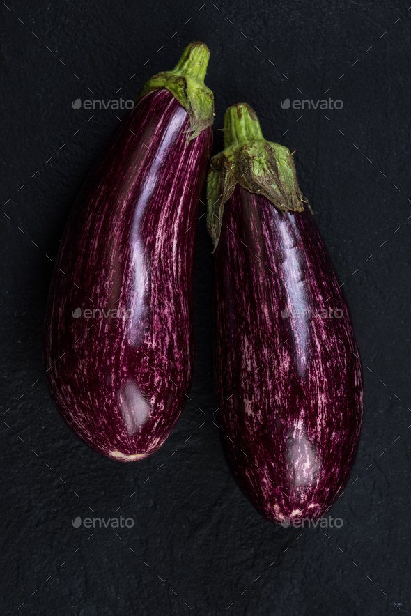 Pink or purple aubergine on dark slate - Stock Photo - Images