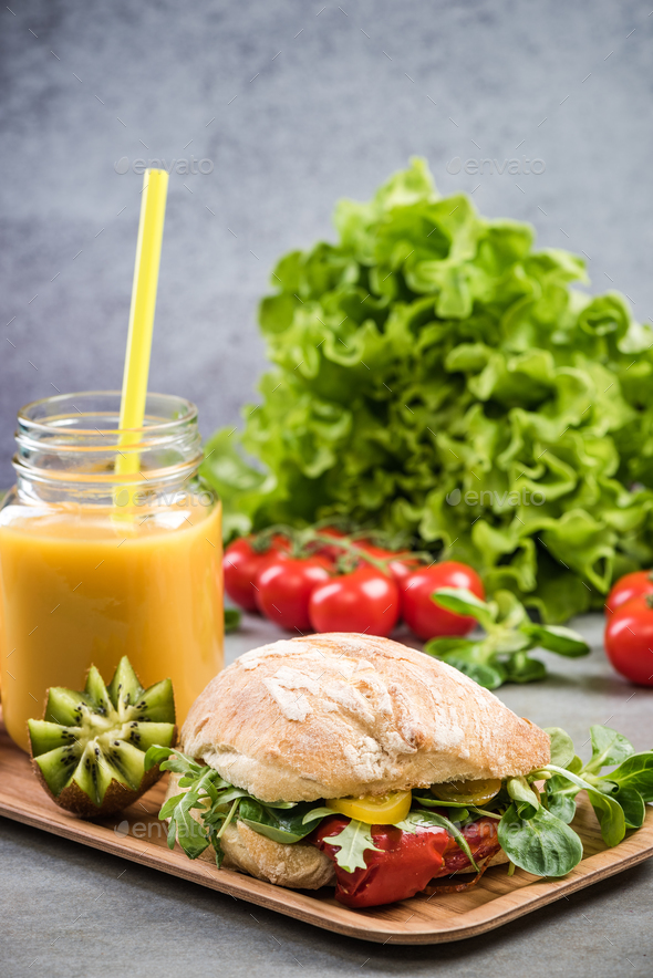 Healthy sandwich bun,smoothie on breakfast tray - Stock Photo - Images