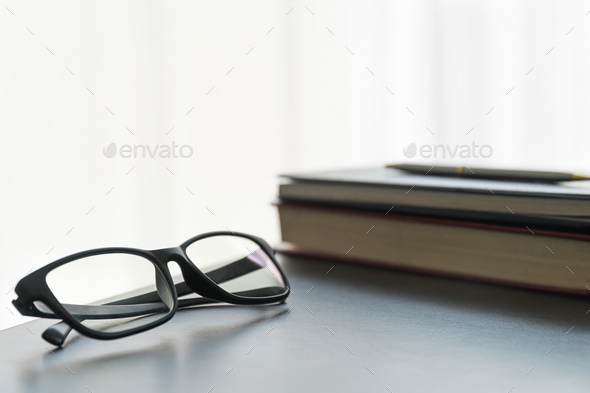 Glasses and book on the desk - Stock Photo - Images