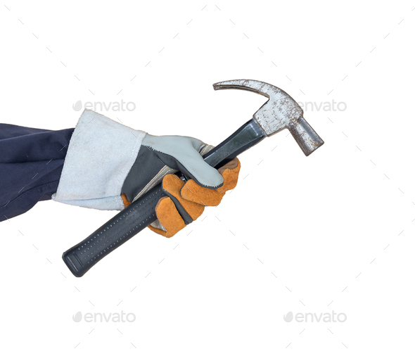 Hand in glove holding hammer on white - Stock Photo - Images