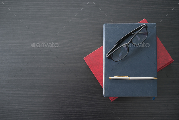 Glasses and book on the wood desk-5 - Stock Photo - Images